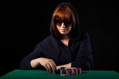 Woman playing poker Royalty Free Stock Image