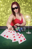 Woman playing poker Royalty Free Stock Photos