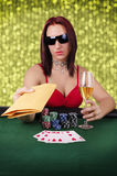Woman playing poker Stock Image