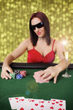 Woman playing poker Stock Images