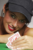 Woman playing poker at a table Royalty Free Stock Images