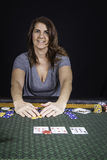 A woman playing poker at a table Stock Photos
