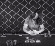 A woman playing poker at a table Royalty Free Stock Image
