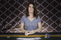 A woman playing poker at a table Royalty Free Stock Images
