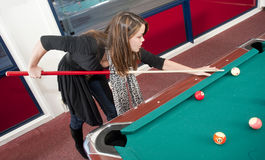 Woman playing pool Stock Images