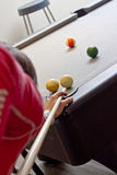 Woman Playing Pool. A woman plays a game of 8 ball pool Royalty Free Stock Image
