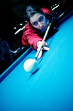 Woman playing pool Royalty Free Stock Photography