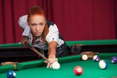Woman playing pool. Stock Photos