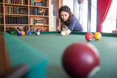 Woman playing pool stock photos