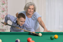 Woman Playing pool with grandson Stock Photography