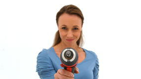 Woman playing with a power drill Stock Photos