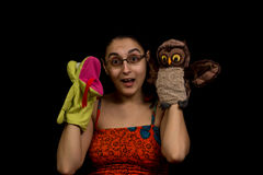 Woman playing with puppets Stock Photography