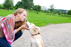 Woman playing  with puppy outdoor. The sexy woman playing with golden retriever puppy Royalty Free Stock Photo