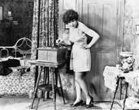 Woman playing record player. (All persons depicted are no longer living and no estate exists. Supplier grants that there will be no model release issues Stock Photography
