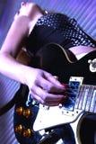 Woman playing rock guitar Royalty Free Stock Image