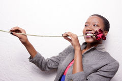 Woman playing a rose Stock Image