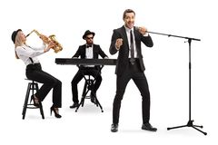 Woman playing sax, man playing a keyboard and a male singer singing on a microphone stock image