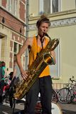 Woman playing the sax at the street-festival in Ghent, Belgium Royalty Free Stock Photos