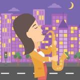 Woman playing saxophone. Royalty Free Stock Photo