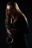 Woman playing saxophone Royalty Free Stock Image