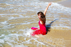 Woman playing in sea Royalty Free Stock Image