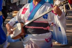 Woman playing shamisen on Awa Odori traditional japanese dance festival. Woman playing shamisen during Awa Odori traditional japanese dance festival royalty free stock images