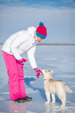 Woman playing with a Siberian Husky Stock Photo
