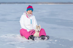 Woman playing with a Siberian Husky Stock Image