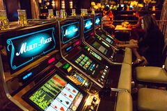 Woman playing at slot machines Royalty Free Stock Photos