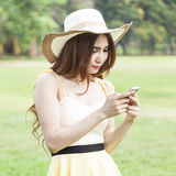 Woman playing smart phone. Royalty Free Stock Image