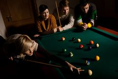 Woman playing snooker Stock Image