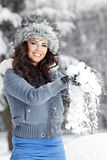 Woman playing with snow Royalty Free Stock Image