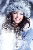 Woman playing with snow Royalty Free Stock Images