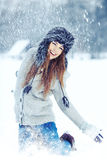 Woman  playing with snow in park Royalty Free Stock Photo