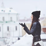 Woman playing with snow in winter Royalty Free Stock Photography