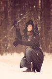Woman playing with snow Stock Images