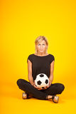 Woman playing with a soccer ball Stock Image