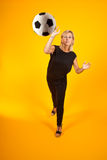 Woman playing with a soccer ball Royalty Free Stock Images