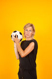 Woman playing with a soccer ball Royalty Free Stock Photography