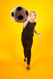 Woman playing with a soccer ball Stock Images