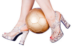 Woman playing soccer in high heels Stock Photo