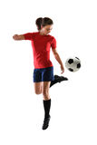 Woman Playing Soccer. Woman kicking soccer ball with back heel royalty free stock photo