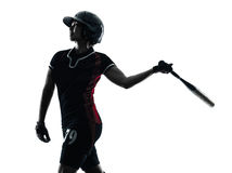 Woman playing softball players silhouette isolated. One woman playing softball players in silhouette isolated on white background Royalty Free Stock Photo