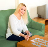 Woman playing solitaire at home Royalty Free Stock Image