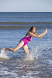 Woman playing and splashing in the ocean royalty free stock photography