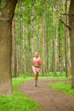 Woman playing sports, running in the park Royalty Free Stock Photography