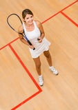 Woman playing squash Royalty Free Stock Photo