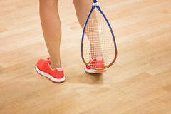 Woman playing squash. A young squash player,squash court Royalty Free Stock Images