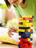 Woman playing stack wood game Royalty Free Stock Image
