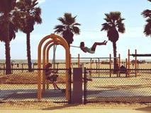 Woman Playing Swing Near Beach stock photos